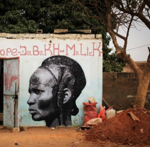 Art. French Street Artist YZ Pays Homage to the Warrior Women of Dahomey on the Walls of Senegal.