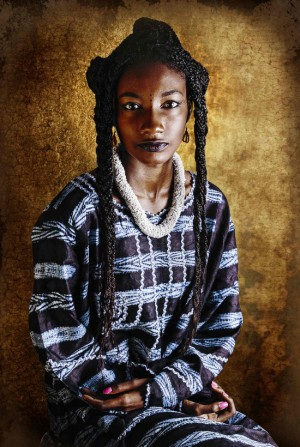 Images. African Women Wear Their Grandmother's Clothes to Honor The Past and Preserve Their Family Histories.